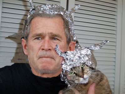 George Bush and cat in tin foil hat